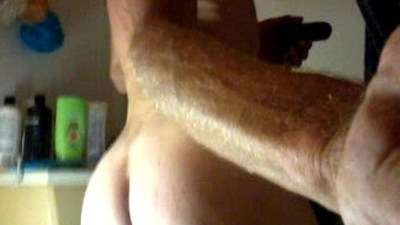 tearing up his asshole with a big black dildo